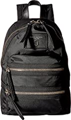 A nylon Marc Jacobs mini backpack with chunky zippers at the front pockets and top. Unlined interior. Leather locker loop and adjustable shoulder straps.