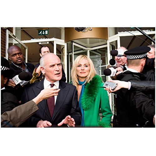 (Basic Instinct 2 Sharon Stone as Catherine Trammell in Sharp Green Coat Interviewed by Reporters 8 x 10 inch photo)