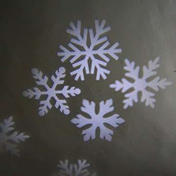 c258629a233 Proyector de luz con formas de copos de nieve  Amazon.es  Iluminación