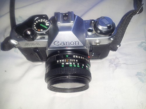 Program 1 Ae Manual Canon (Canon AE-1 35mm SLR Manual Focus Camera w/ FD 50mm lens)