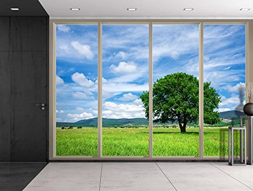 Clouds Over Mountains and a Lone Tree on a Green Field Viewed From Sliding Door Creative Wall Mural Peel and Stick Wallpaper