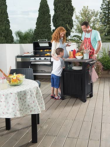 51 8WJLMIDL. AC Keter Unity Portable Outdoor Table and Storage Cabinet with Hooks for Grill Accessories-Stainless Steel Top for Patio Kitchen Island or Bar Cart, Dark Grey    This plastic outdoor kitchen storage table with wheels combines two storage solutions in one, providing a stainless steel top for serving drinks or condiments and a cupboard for storing extra supplies. It works perfectly for a family barbecue or any friendly gatherings on the deck, giving you extra serving and storage space for plates, water bottles and more. Place snacks on the durable surface for friends to grab any time, and keep cloth napkins or grilling utensils hung easily within reach on the additional hooks.