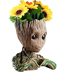 """➤ Package included: 1x Baby Groot Flowerpot➤ About this item: 1.What are the dimensions of the actual flower pot where the plant will go? 3"""" deep, 2.5"""" wide at it's widest. There is also a small drainage hole, so that the water will leak out when use..."""