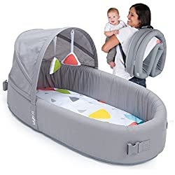 Lulyboo Bassinet to-Go Metro Portable Travel Newborn Baby Infant Bed for Sleep and Play Waterproof Base Breathable Portable and Folds Into A Backpack Includes Toy Bar Canopy 2 Toys