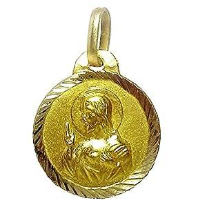 Medalla oro 18K lisa filo labrado. Escapulario con imagen de la Virgen del Carmen y Corazón de Jesús.Diámetro: 14mm.. Longitud asas: 5 mm..Peso: 1,3gr..