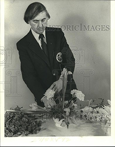 Stock Harwood (Vintage Photos 1979 Press Photo Florist Claude Harwood Jr. on steps in flower arrangement)