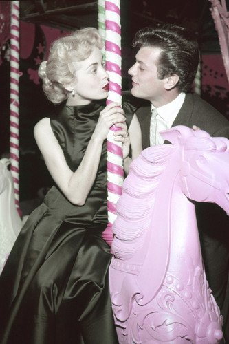 Tony Curtis Janet Leigh on merry go round attending Universa