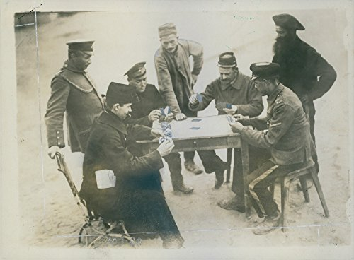 Vintage photo of Soldiers playing a card during the WWI, - Playing Soldiers Cards