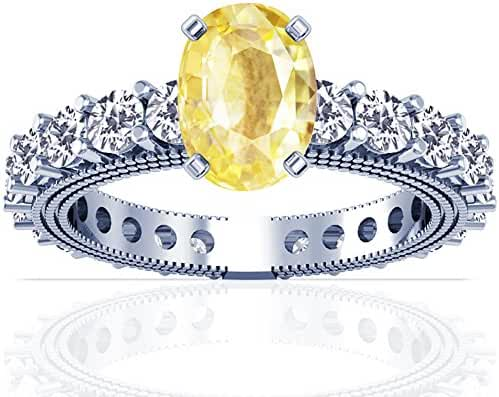 Platinum Oval Cut Yellow Sapphire Ring With Sidestones