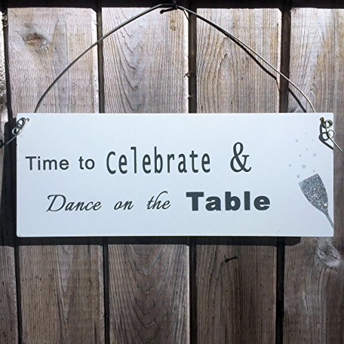 TIME TO CELEBRATE AND DANCE ON THE TABLE, Champagne Glass with Glitter, Festive Party Style, White MDF Wood, Gray Metal Wire Hanger, 4 3/8 x 11 Inches, By Whole House Worlds