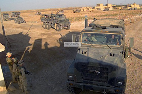 Photo A US Marine Corps (USMC) convoy of 5-ton carrier trucks enters the 2nd Battalion, 6th Marines base camp guard post, just outside of Muwaafaqiyah, Iraq, during Operation IRAQI FREEDOM, 04/23/2003