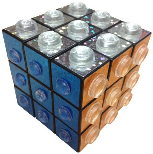 - The Braille Store Tactile Turn-A-Cube With Raised Shapes