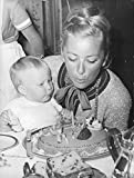 Vintage photo of Queen Paola of Belgium helping baby King Philippe blow his birthday cake.- 1961