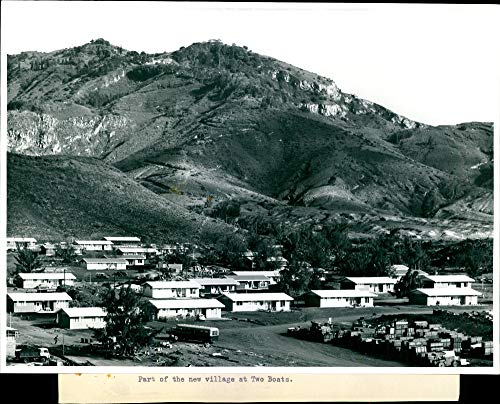 Vintage photo of Part of the new village at two boats. ()