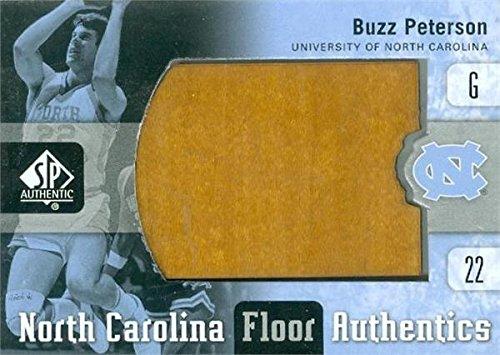 (Buzz Peterson game used floor piece basketball card (North Carolina Tar Heels) 2011 Upper Deck Floor Authentics #UNC-BP)