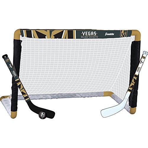 - NHL Franklin Sports Las Vegas Golden Knights Mini Hockey Knee Hockey Goal, Ball & 2 Stick Combo Set - 28