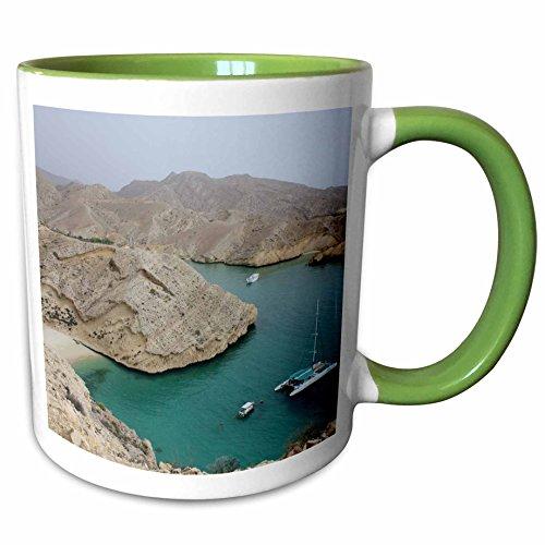 3dRose Albom Design Travel - Catamaran Anchored Outside Muscat, Oman Photo by Rhonda Albom - 15oz Two-Tone Green Mug (mug_164778_12)