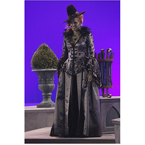 Rebecca Mader Once Upon a Time as Wicked Witch facing left in front of topiary urn and wastebasket on chroma key set 8 x 10 Inch Photo