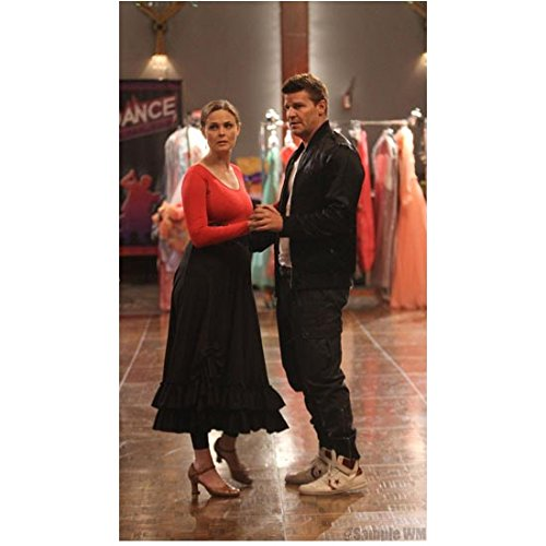 (Bones (8 inch by 10 inch) PHOTOGRAPH Emily Deschanel Red Top Black Skirt & David Boreanaz Black Jacket Over White Tee & Jeans Practicing Dancing Pose 1 kn)