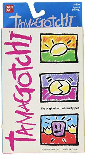 (Original V1 1996/1997 Tamagotchi Gold Virtual Reality Pet by Bandai)
