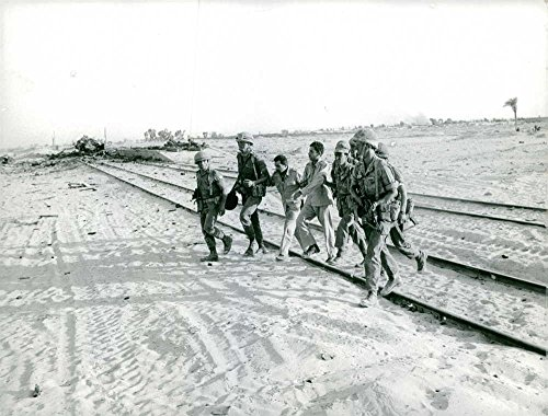 (Vintage photo of Soldiers carrying men at border, scene of)