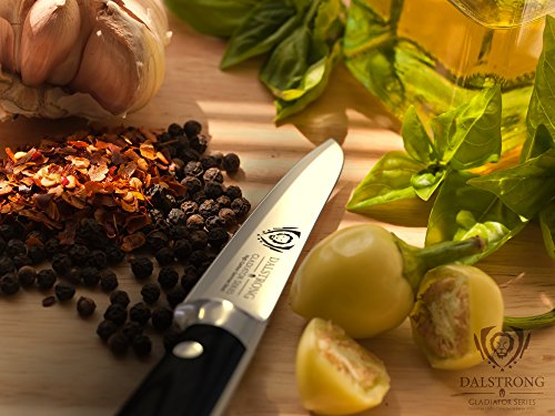 """DALSTRONG Paring Knife - Gladiator Series Paring Knife - German HC Steel - 3.5"""" 3 Outstanding craftsmanship, cutting-edge technology, stunning design elements, and premium materials. Peak performance has never looked so good at this price. Incredibly razor sharp paring knife, full-tang, imported high-carbon German steel with a hand polished edge at 14-16 degrees per side. Precisely tempered and stain resistant. The ultimate paring knife. Award winning design, with satisfying heft, premium materials and quality feel. Luxury imported black pakkawood handle is triple-riveted with a grip that ensures comfort and maneuverability. Laminated and polished for a sanitary build, perfect for busy kitchens"""