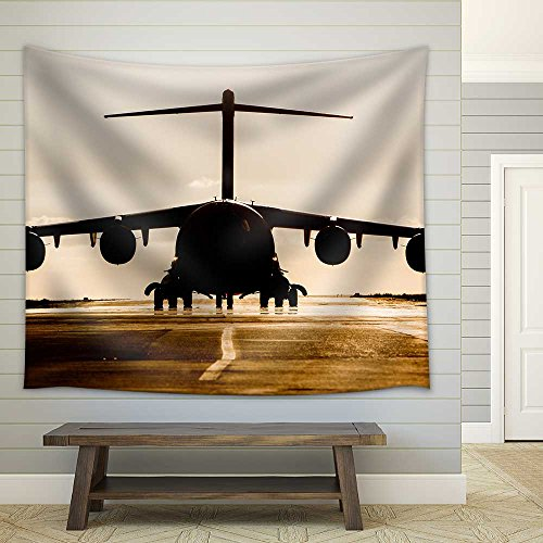 Large military cargo plane silhouette on an empty airstrip Fabric Wall Tapestry