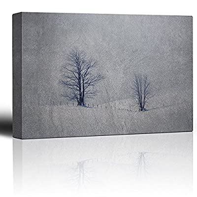 Lone Trees on Hills of Snow Against a Grainy Background