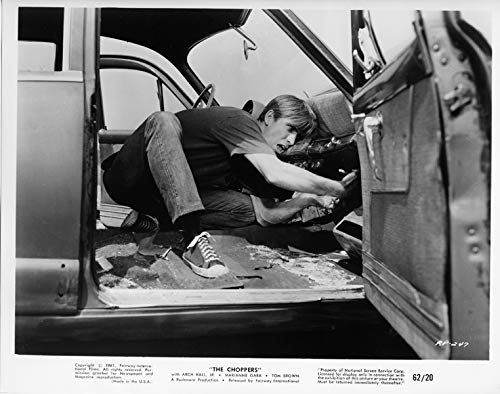 (The Choppers original 1962 8x10 photo youth tries to remove parts from Chevy)