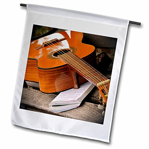 3dRose Music - Image of Closeup Acoustic Guitar On Book - 12 x 18 inch Garden Flag (fl_255451_1)