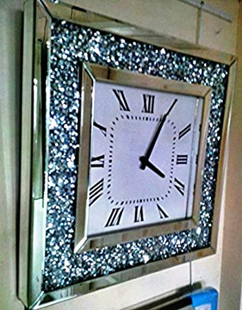 A Floating Crystal Wall Clock with Bevelled Mirror Glass and a