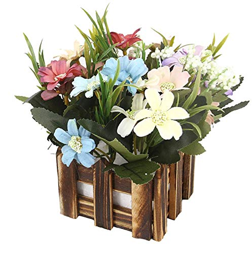 artificial flowers arrangement in wood pot