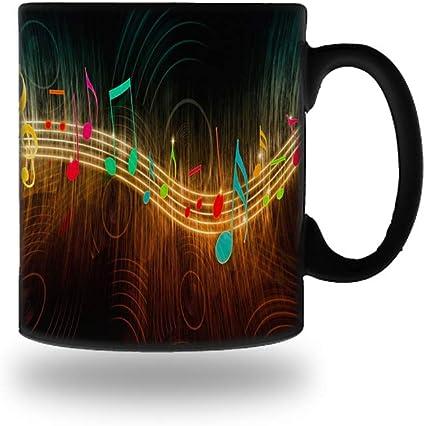 Amazon.com: Taza mágica de cerámica con símbolos de música ...