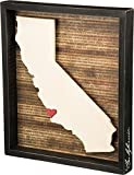This wooden inset box sign features a dimensional California state silhouette, background list of the most populated cities, and adhesive mini heart to place on a hometown or favorite spot. Includes a back sawtooth hanger or can free-stand alone on a...