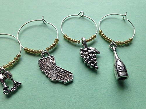 California Wine Charms, Gift for California Wine Lover. Charms include California State charm, wine bottle, corkscrew, Cheers with glasses, grapes, and picnic basket. Set of 4 to Set of ()