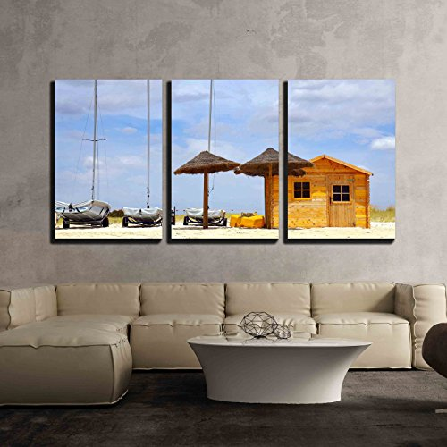 wall26 - 3 Piece Canvas Wall Art - Three Parked Boats in the Beach Sand Next to a Wooden Shack and Sun-Shades - Modern Home Decor Stretched and Framed Ready to Hang - 24