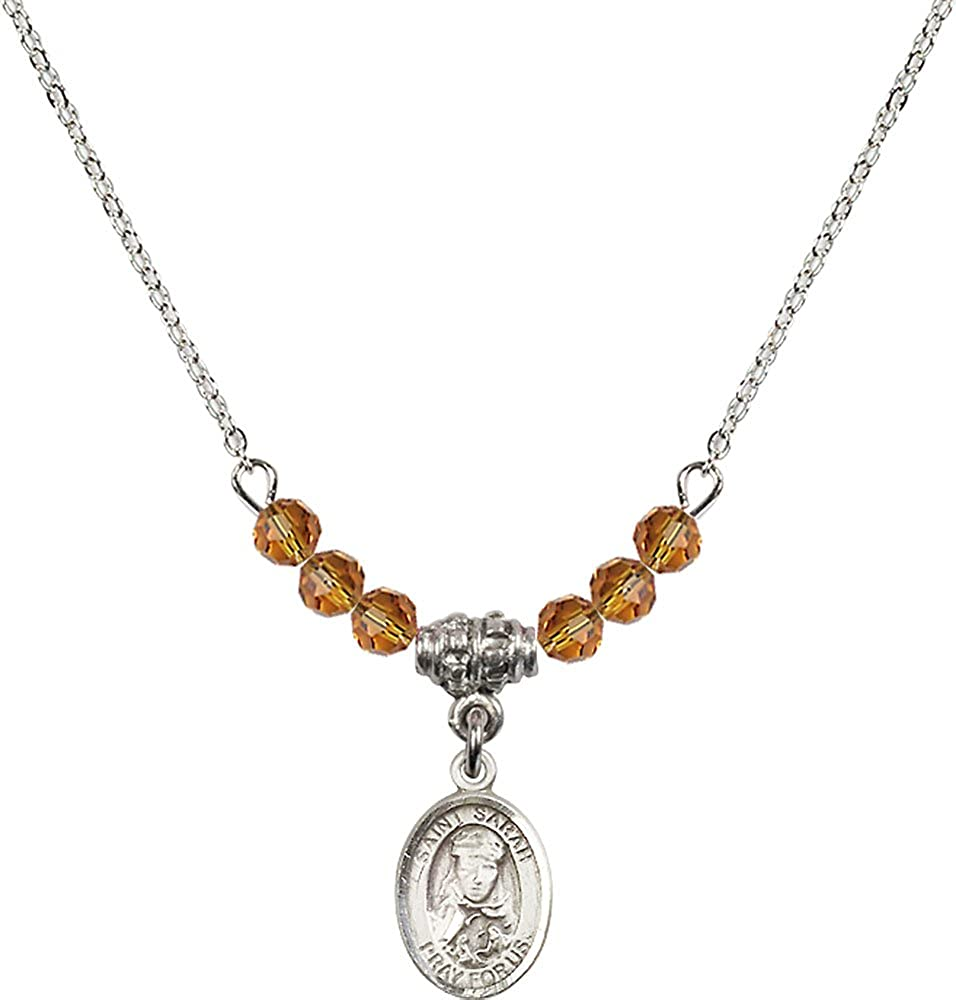 18-Inch Rhodium Plated Necklace with 4mm Topaz Birthstone Beads and Sterling Silver Saint Sarah Charm.