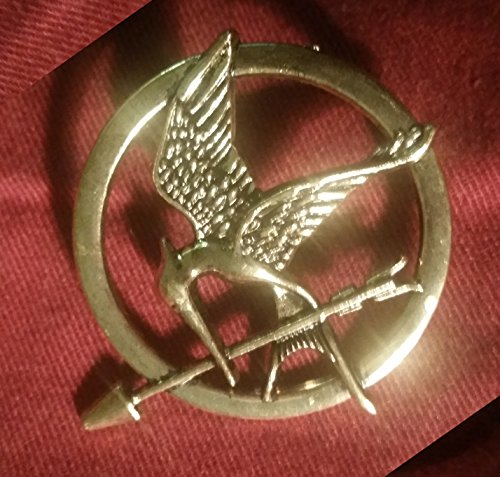 The Hunger Games Katniss Everdeen Cosplay Prop Mockingjay Pin Brooch Badge]()