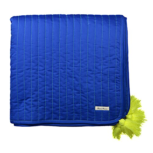 A stylish luxury quilt in blue with neon yellow stitched details and tassels. The quilt comes in a coordinating drawstring bag.