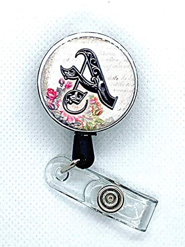 - Personalized Monogram Badge Reel. Retractable badge holder with fancy script lettering and floral print. Pick your initial.