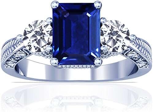 Platinum Emerald Cut Blue Sapphire Three Stone Ring