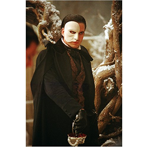 Phantom of the Opera (2004) 8 inch x 10 inch PHOTOGRAPH Gerard Butler in White Half Mask in Black Suit & Cape Tip of Sword Straight Down on Floor kn ()