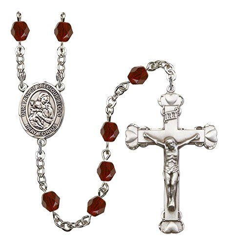 Garnet Rosary Crucifix - Silver Plate Rosary features 6mm Garnet Fire Polished beads. The Crucifix measures 1 5/8 x 1. The centerpiece features a O/L of the Precious Blood medal.
