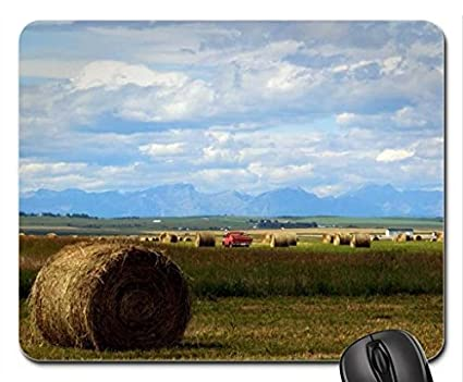 Hay Rolls And Rocky Mountains On The Back Mouse Pad