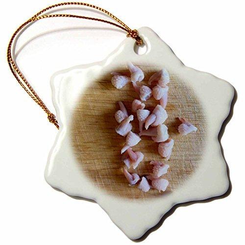 OneMtoss Henrik Lehnerer Designs Food Chicken feet toenails on a Brown Cutting Board. Snowflake Porcelain Ornament -
