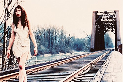 Twin Peaks cult tv series Ronette Pulaski as girl walking on train tracks 18x24 Poster by Generic