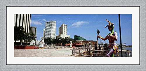 Jester statue with buildings in the background, Riverwalk Area, New Orleans, Louisiana, USA by Panoramic Images Framed Art Print Wall Picture, Flat Silver Frame, 44 x 20 - Riverwalk Louisiana