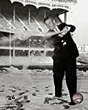 Mickey Mantle hits a snowball after signing his contract for the 1957 season at Yankee Stadium Photo Print (20 x 24)