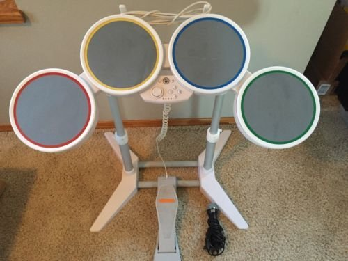 Nintendo Wii Rock Band Drum Set, Foot Pedal, drum sticks, microphone, and copy of wii rock band.guitar hero.