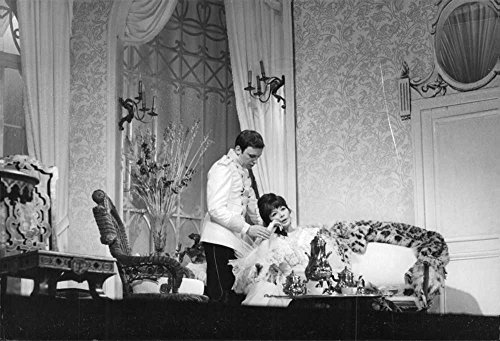 Vintage photo of Jean Louis Trintignant with Juliette Greco in a scene from a play, 1964. (Greco Jeans)